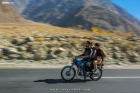 Panning shot of bikers on the Karakoram Highway in Gilgit Baltistan