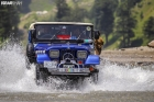 Mercedeze 4x4 rovering over the flowing water in Kaghan KPK