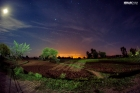 A view of fields and sky at night in the moonlight in Kohat KPK